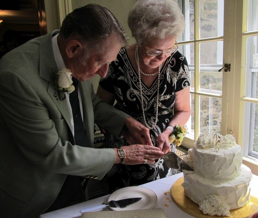 couple cutting cake